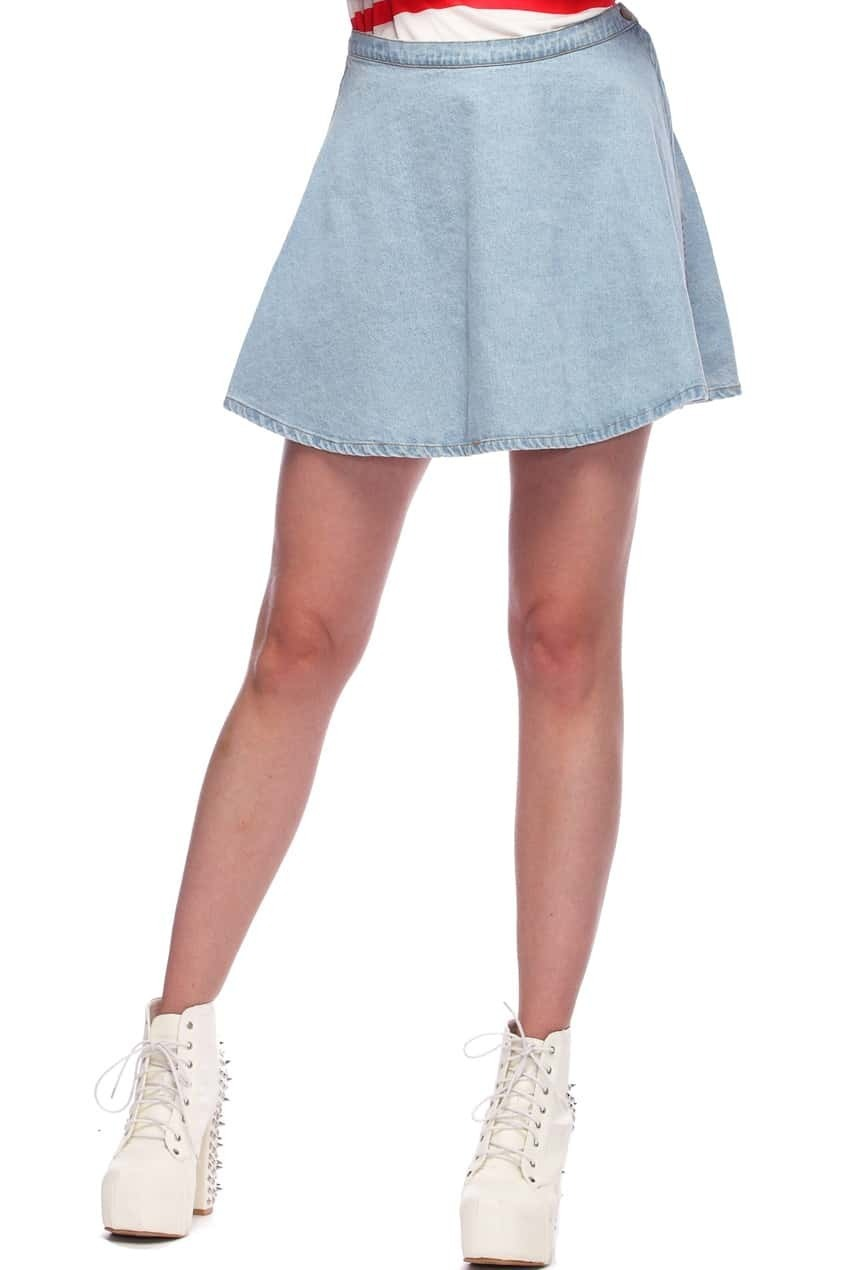 This plus size denim skirt is made super comfortable with a wide elastic waistband. The A-line shape flatters the figure using topstitched, felled seams to create a lovely shape. Made in soft denim with a little bit of stretch for fit and comfort.