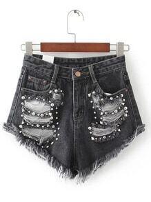Shorts rotos en denim con detalle de tachuelas - negro