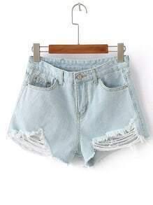 Shorts con detalle de rotura en denim - azul