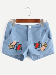 Shorts con parche de flor en denim - azul