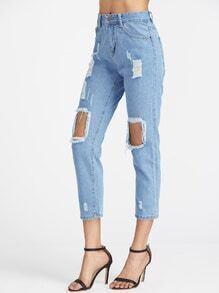 Beunruhigte zerrissene Knie Jeans