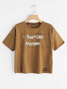 Camiseta rota estampada de lema