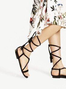 Sandalias planas con cordones y borlas
