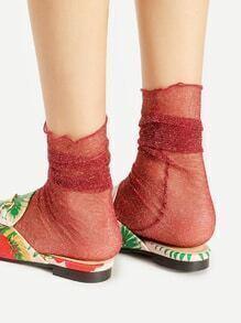Calcetines con brillos con costuras en la parte lateral