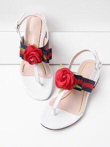 Sandalias planas con adornos de flor