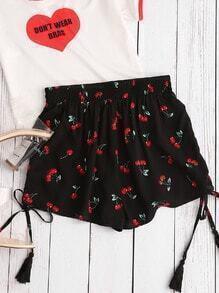 Shorts avec des plis et des franges et un élastique