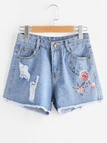 Shorts rotos de borde crudo bordado de flor
