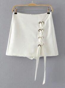Falda-pantalón con cordones y espalda con cremallera