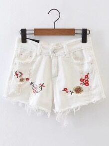 Shorts en denim bordado de flor de borde crudo