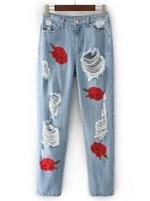Jeans fendues avec des broderies de rose